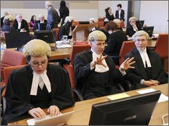 A legal counsel member, center, gestures during proceedings in Parramatta Court, west of Sydney, Australia, on Tuesday, Oct. 7, 2008. New South Wales Supreme Court judge Justice Anthony Whealy presiding over the trial of five Sydney men accused of a terrorist conspiracy has told the jury to clear any anti-Muslim bias from their minds Tuesday, Nov. 11, 2008. (AP Photo/AAP Image, Paul Miller, POOL)