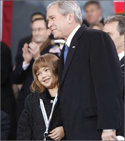 President Bush hugs Taylor Pokorney in New York, Tuesday, Nov. 11, 2008, after she gave him a drawing she made during the rededication ceremony of the Intrepid Sea, Air and Space Museum. Her father, Marine Lt. 1st Class Fred Pokorney, was killed in Iraq in 2003.  (AP Photo/Gerald Herbert)