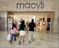 In this Aug. 12, 2008 file photo, a family walks into a Macy's store in San Jose, Calif., Tuesday, Aug. 12, 2008. Department store operator Macy's Inc. reported Wednesday, Nov. 12, 2008, that its third-quarter results swung to a loss from a profit a year ago as results were hampered by a drop in consumer spending amid a deteriorating economy. (AP Photo/Paul Sakuma, File)