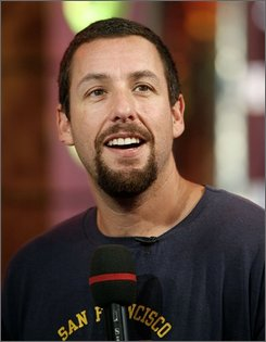"""In this July 16, 2007 file photo, Adam Sandler appears onstage during MTV's """"Total Request Live"""" at the MTV Times Square Studios in New York.   (AP Photo/Jason DeCrow, file)"""