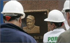 Workers prepare a monument to Babe Ruth to be moved from Monument Park in Yankee Stadium to the new Yankee Stadium Wednesday, Nov. 12, 2008  in New York. (AP Photo/Frank Franklin II)
