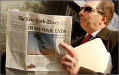 A man reads a spoof copy of the New York Times with the headline that the Iraq war has ended in New York, Wednesday, Nov. 12, 2008.  About 1.2 million copies of a 14-page Times parody were handed out by 1,000 volunteers on behalf of prankster activists who say they want to make sure the newly elected Obama administration keeps its promises. (AP Photo/Kathy Willens)