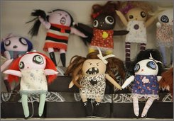 A selection of handmade dolls are seen on a shelf at Renegade Handmade, a craft consignment shop Tuesday, Nov. 11, 2008 in Chicago. Shop owner Sue Daly says that despite a nationwide decline in retail sales, her business is holding steady. Many people are turning to the handmade and craft movement as a way to save money with the downturn in the economy. (AP Photo/M. Spencer Green)