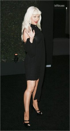 "Singer Christina Aguilera arrives at the Louis XIII Black Pearl Hosts Matthew Rolston's "" beautyLIGHT "" Book Launch, Monday, Nov. 10, 2008, in Beverly Hills, Calif. (AP Photo/Gus Ruelas)"