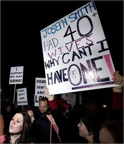 this Nov. 7, 2008 file photo shows people gathering before marching on the Mormon Temple in protest Friday, Nov. 7, 2008, in Salt Lake City. Supporters of gay marriage, frustrated over a ballot-box defeat in California, have channeled much of their anger toward the towering white spires of Mormon temples. (AP Photo/Douglas C. Pizac,File)