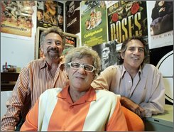 Bob Emmer, left, Richard Foos, center, and Garson Foos pose with period movie posters and a Capt. Fantastic pinball machine in the Shout! Factory headquarters in Los Angeles, Wednesday, Oct. 8, 2008.  As CEO of the Shout! Factory, Richard Foos runs an emporium whose credo might be