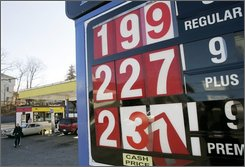 Gas prices at a filling station in Dedham, Mass., appear on display Wednesday, Nov. 12, 2008. Oil prices dropped below $57 a barrel Wednesday as a Bank of England warning about the risk of deflation stoked fears of stagnating global growth. (AP Photo/Steven Senne)