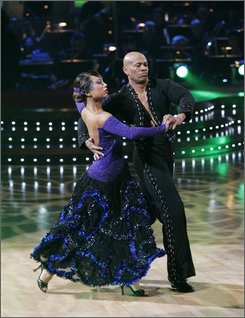 "In this image released by ABC, Maurice Green and his partner Cheryl Burke perform on ""Dancing with the Stars,"" Monday, Nov. 10, 2008, in Los Angeles. (AP Photo/ABC, Kelsey McNeal)"