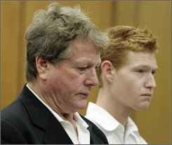 Actor Ryan O'Neal, front, and his son Redmond O'Neal appear for arraignment on methamphetamine possession charges, at the courthouse in Malibu, Calif., Thursday, Nov. 11, 2008.  Redmond O'Neal, 23, also faces misdemeanor charges for possession of drug paraphernalia and possession of pepper spray. The father and son were arrested Sept. 17 after deputies searched their Malibu home, part of the younger Redmond's probation.  (AP Photo/Reed Saxon, pool)