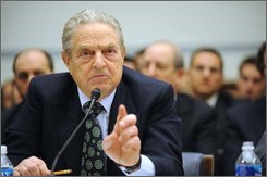 """Soros Fund Management Chairman George Soros testifies on Capitol Hill in Washington, Thursday, Nov. 13,2008, before  the House Oversight and Government Reform hearing on """"Hedge Funds and the Financial Market"""". (AP Photo/Kevin Wolf)"""