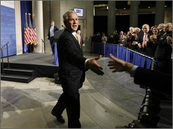 President George W. Bush greets guests after making remarks on the financial markets and the World economy at Federal Hall in New York, Thursday, Nov. 13, 2008.  (AP Photo/Gerald Herbert)