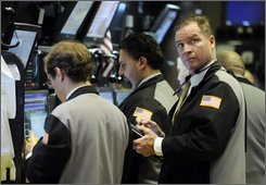 Traders work on the floor of the New York Stock Exchange Thursday, Nov. 13, 2008. (AP Photo/Richard Drew)