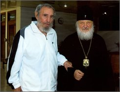 In this Oct. 20, 2008 photo made available on Nov. 13, 2008 by the Russian Orthodox Church, Cuba's former President Fidel Castro, left, stands with Russia's Metropolitan Kirill, of Smolensk and Kaliningrad, in Havana. Cuba's first Russian Orthodox cathedral was inaugurated on Oct. 19, 2008.  (AP Photo)