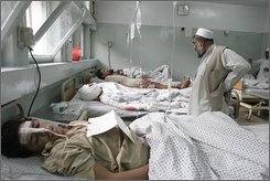 Afghan victims receive treatment at a hospital after they were injured in a suicide attack in Batti Kot district of Nangarhar province, Afghanistan, Thursday, Nov. 13, 2008. A suicide car bomber struck a U.S. military convoy passing through a crowded market in eastern Afghanistan Thursday, killing at least 20 civilians and a U.S. soldier and wounding an additional 74 civilians, officials said. (AP Photo/Rahmat Gul)