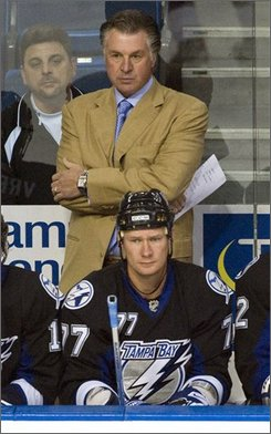 In this Sept. 23, 2008 file photo, Tampa Bay Lightning head coach Barry Melrose, right, and assistant coach Rick Tocchet watch action during the first period of a preseason NHL hockey game against the New York Rangers in Tampa, Fla. The Lightning fired Melrose on Friday, Nov. 14, 2008, just 16 games into the season.  Assistant Rick Tocchet was appointed interim head coach. (AP Photo/Mike Carlson, File)