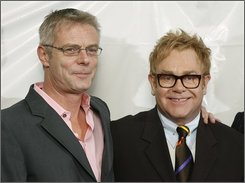 Director Stephen Daldry, left, and musician Elton John, arrive to the Broadway opening of their show Billy Elliot The Musical, in New York, Thursday, Nov. 13, 2008. (AP Photo/Stuart Ramson)