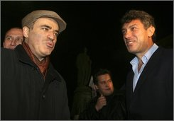 Opposition leaders Garry Kasparov, left, former chess champion, and Boris Nemtsov, right, speak to the media during a protest against extention of presidential term in Moscow, Friday, Nov. 14, 2008.  About 100 opposition activists gathered for a protest as Russian lawmakers voted to extend the term of the president from four years to six on Friday. (AP Photo/Mikhail Metzel)