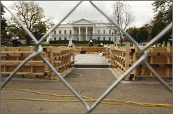 With the White House in the background, workers continue to build the Presidential inauguration reviewing stand in Washington, Friday, Nov. 7, 2008. On January 20, 2009, President Obama and guests will view the inaugural parade from the stand. (AP Photo/Gerald Herbert)