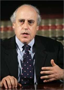 In this March 28, 2005 file photo, Motion Picture Association of America, Inc. (MPAA) President and Chief Executive Officer Dan Glickman gestures during an interview with The Associated Press in Washington. Glickman was agriculture secretary under President Bill Clinton, whose administration is being tapped by President-elect Barack Obama for expertise as he prepares to take office. (AP Photo/Lawrence Jackson, File)