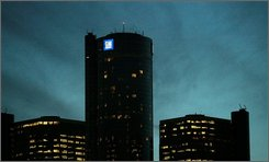 The General Motors headquarters is seen at dusk in Detroit, Thursday, Nov. 13, 2008. GM, the nation's largest automaker, posted a $2.5 billion quarterly loss last Friday and has predicted it could run out of cash by the end of the year without government help. (AP Photo/Carlos Osorio)