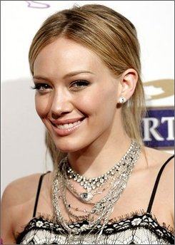 "In this Oct. 15, 2008 file photo, actress Hilary Duff poses on the press line at the ""Project Runway"" Fifth Season Finale party in Los Angeles. (AP Photo/Dan Steinberg, file)"