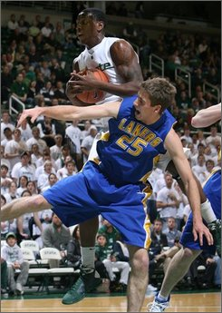 Lake Superior State's Mark Morse (25) and Michigan State's Raymar Morgan fight for a rebound during the first half of an NCAA college basketball exhibition game Monday, Nov. 10, 2008, in East Lansing, Mich. (AP Photo/Al Goldis)