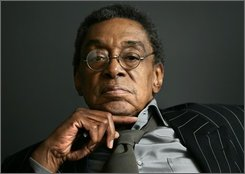 "This March 6, 2006, file photo shows former host of the television show ""Soul Train,"" Don Cornelius at his office in Los Angeles. Cornelius, was charged with spousal battery, assault with a deadly weapon and dissuading a witness from making a police report, the Los Angeles city attorney said Friday, Nov. 14, 2008.  (AP Photo/Damian Dovarganes, file)"
