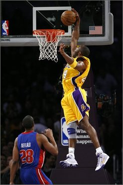 Los Angeles Lakers guard Kobe Bryant (24) makes the alley-oop dunk in first half of an NBA basketball game against the Detroit Pistons, Friday, Nov. 14, 2008, in Los Angeles. (AP Photo/Gus Ruelas)