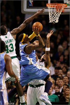 Denver Nuggets forward Carmelo Anthony, center, drives to the basket against Boston Celtics guard Paul Pierce, right, and Boston Celtics center Kendrick Perkins (43) during the first half of an NBA basketball game in Boston., Friday, Nov. 14, 2008.  Anthony had 18 points in their 94-85 win over the Celtics. (AP Photo/Charles Krupa)