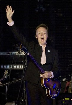 """This is a Thursday, Sept. 25, 2008. file photo of former Beatle Sir Paul McCartney as he  waves during a concert in Tel Aviv, Israel.  McCartney says it's time an experimental Beatles track saw the light of day.  McCartney says he wants to release """"Carnival of Light,"""" a 14-minute experimental track the Fab Four recorded in 1967 but never released.  The band played the recording for an audience just once, at an electronic music festival in London. It reportedly includes distorted guitar, organ sounds, gargling and shouts of """"Barcelona!"""" and """"Are you all right?"""" from McCartney and John Lennon. (AP Photo/Bernat Armangue)"""