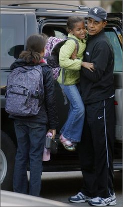 In this Nov. 10, 2008 file photo, President-elect Barack Obama, right, lifts his daughter Sasha out of his vehicle as daughter Malia looks on as he dropped them off at school in Chicago.  (AP Photo/Charles Dharapak, File)