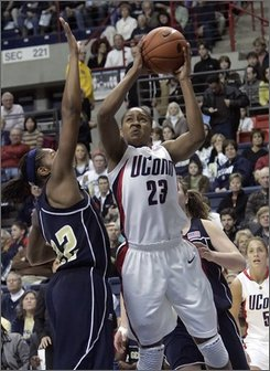 Connecticut's Maya Moore (23) goes up for a shot as Georgia Tech's Alex Montgomery defends in the first half of an NCAA women's college basketball game in Storrs, Conn. on Sunday, Nov. 16, 2008.  (AP Photo/Bob Child)