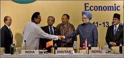 Indian Prime Minister Manmohan Singh, second right, shakes hand with Sri Lanka's president Mahinda Rajapaksa, second left, as Myanmar's Prime Minister Thein Sein, left, Bangladesh's Chief Advisor Fakhruddin Ahmed, Bhutan's Prime Minister Jigme Thinely and  Nepal's Prime Minister Pushpa Kamal Dahal Prachanda, right, looks on at the end of the second summit of second Bay of Bengal Initiative for Multi Sectoral Technical and Economic Cooperation, in New Delhi, India, Thursday, Nov. 13, 2008. (AP Photo/Manish Swarup)