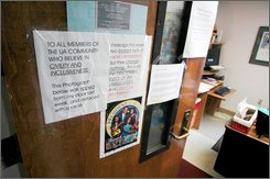 Signs hang on the office door of University of Alabama professor Marsha L. Houston, Thursday, Nov. 13, 2008, in Tuscaloosa, Ala., as Houston posted a message against racism after someone defaced a previous poster of Barack Obama and his family with a death threat and racial slur. (AP Photo/Jay Reeves)