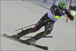 Bode Miller, of the United States, races to the second place, during an alpine ski, World Cup Men's Slalom, in Levi, Finland, Sunday, Nov. 16, 2008. (AP Photo/Giovanni Auletta)