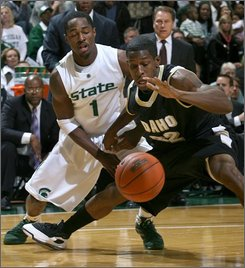 Idaho's Kashif Watson, right, and Michigan State's Kalin Lucas (1) chase the ball during the first half of an NCAA men's college basketball game Sunday, Nov. 16, 2008, in East Lansing, Mich. (AP Photo/Al Goldis)