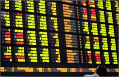 A man looks at a screen showing stock prices at the Korea Stock Exchange in Seoul, South Korea, Monday, Nov. 17, 2008. The Korea Composite Stock Price Index fell 9.94 points, or 0.91 percent, to 1,078.32. (AP Photo/Lee Jin-man)