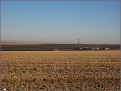A drill rig is seen Nov. 22, 2008, on wide-open land near Eltopia, Wash., where Easterday Ranches Inc. is proposing a 30,000-head feedlot. Some area residents are fighting the proposal, not just because they oppose increased traffic or dust, but because they fear the water that will be pumped for the cattle will dry up their domestic wells. (AP Photo/Shannon Dininny)