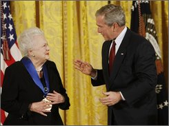  President George W. Bush talks to actress Olivia de Havilland in the East Room of the White House in Washington, Monday, Nov. 17, 2008, after presenting her with a 2008 National Medals of Arts. (AP Photo/Gerald Herbert)