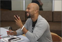 In this 2008 photo provided courtesy of  Microsoft, Hip-hop veteran Common visits Microsoft's Zune headquarters in Redmond, Wash. (AP Photo/Microsoft)