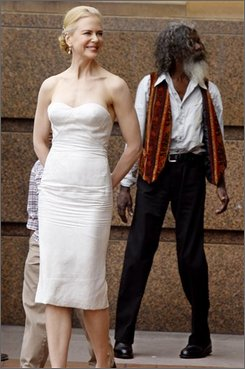 """Australian actor Nicole Kidman smiles a she walks to a photo opportunity following a press conference for her latest movie """" Australia """" in Sydney, Tuesday, Nov. 18, 2008. The world premier will be held in Sydney later Tuesday. (AP Photo/Mark Baker)"""