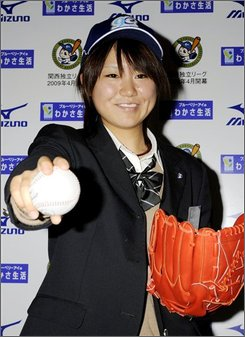 High school student Eri Yoshida, 16, strikes a pose with a ball after being drafted by an independent league's professional team during a press conference in Osaka, western Japan, Sunday, Nov. 16, 2008. Yoshida, who throws a side-arm knuckleball, was drafted by the Kobe 9 Cruise in a new independent Japanese league that will start its first season in April. Yoshida says she wants to follow in the footsteps of Boston Red Sox knuckleballer Tim Wakefield. (AP Photo/Kyodo News)