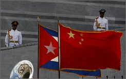 Cuban and China flags wave at the Jose Marti monument during a ceremony for China's President Hu Jintao, unseen, in Havana, Tuesday, Nov. 18, 2008. Jintao is on a two-day official visit to Cuba.(AP Photo/Javier Galeano)