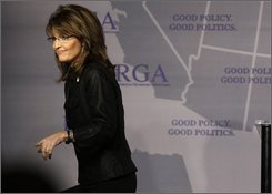 Alaska Gov. Sarah Palin walks off the stage following a speech during the Republican Governors Association Annual Conference in Miami, Thursday, Nov. 13, 2008. (AP Photo/Lynne Sladky)