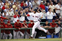 In this June 24, 2008 file photo, Boston Red Sox' Dustin Pedroia reaches for congratulations as he rounds third after hitting a solo home run against the Arizona Diamondbacks in the first inning of their baseball game at Fenway Park in Boston. Pedroia won the American League Most Valuable Player award Tuesday Nov. 18, 2008.(AP Photo/Elise Amendola, File)