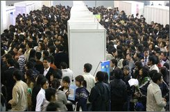 Chinese job-seekers crowd an autumn job fair in Nanjing, east China's Jiangsu province, Sunday, Nov. 16, 2008. Two Chinese provinces are trying to limit companies from laying off large numbers of employees as they struggle to deal with the impact of the global financial crisis. (AP Photo/Color China Photo)
