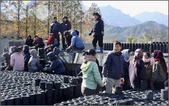 North Korean women unload coal briquettes from South Koran trucks at Goseong near Diamond Mountain in North Korea, Tuesday, Nov. 18,  2008. South Korea called for talks with North Korea on restarting tours to scenic Diamond Mountain resort, a joint project that began 10 years ago Tuesday and had fostered hopes of reconciliation on the divided peninsula. (AP Photo/Yonhap)