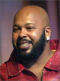 "In this June 24, 2003 file photo, Rap producer Marion ""Suge"" Knight  watches the 3rd annual BET Awards in the Hollywood section of Los Angeles. (AP Photo/Kevork Djansezian, file)"