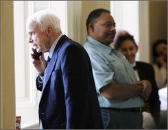 Sen. John McCain, R-Ariz., talks on a cell phone outside a Republican Caucus on Capitol Hill in Washington, Tuesday, Nov. 18, 2008. (AP Photo/Gerald Herbert)