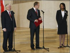 An Aug. 20, 2008 file photo shows Poland's President Lech Kaczynski, left, listening as Polish Prime Minister Donald Tusk, center, address U.S. Secretary of State Condoleezza Rice, right, during a ceremony in Warsaw, in which Poland and the U.S. signed a deal on placing a missile defense system in Poland. Kaczynski's late arrival kept Rice and others waiting,  only one in a recent string of gaffes by the president. (AP Photo/Czarek Sokolowski)